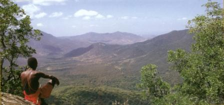 View of Rift Valley with Masai warrior